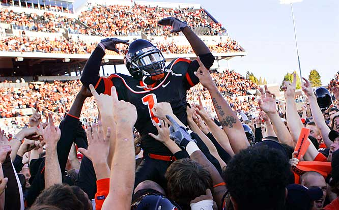 Oregon State's Dennis Christopher celebrated on the shoulders of fans after beating USC, 33-31, in Corvallis, Ore. on Saturday.