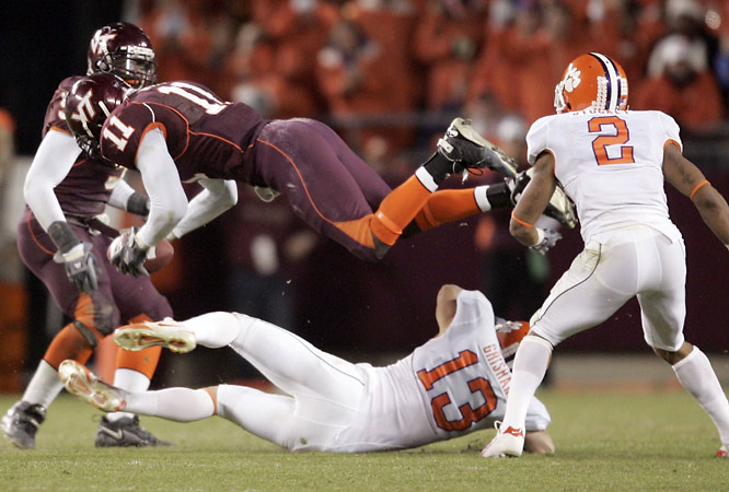 Virginia Tech linebacker Xavier Adibi (11) was tackled by Clemson wide receiver Tyler Grisham (13) Thursday in the Hokies' 24-7 upset of the Tigers.