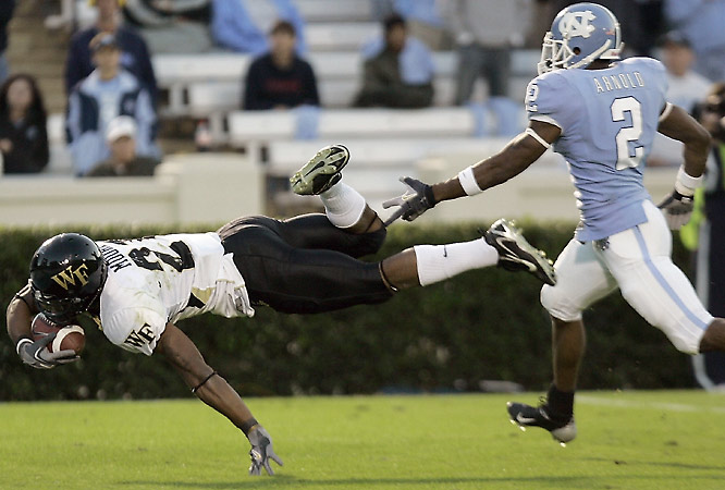 More late heroics were needed in Chapel Hill, N.C., Saturday as Wake Forest overcame a fourth-quarter deficit to escape upset-minded North Carolina. Demon Deacon receiver Kenneth Moore's fourth-quarter TD reception ahead of UNC's Cooter Arnold secured the victory.