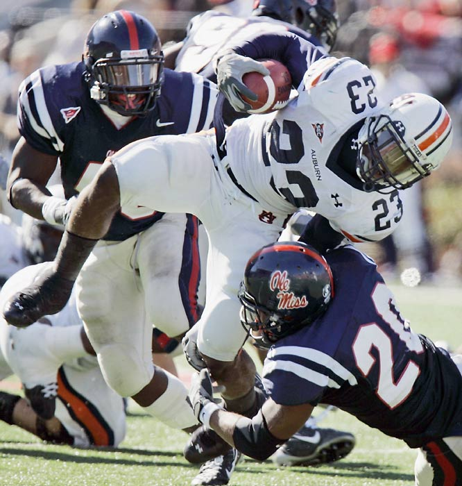 Auburn running back Kenny Irons (23) had to grind it out against Charles Clark and the Ole Miss defense. The Rebels hung tough against the seventh-ranked Tigers, who needed two late field goals to secure the victory.