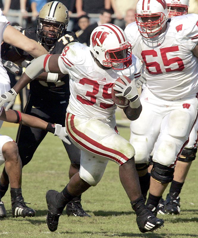 P.J. Hill ran for 161 yards and two touchdowns on 29 carries as the Badgers improved to 7-1 on the season.