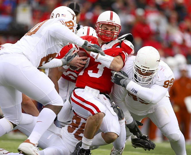 Defensive end Tim Crowder (80) led the Texas defense in sacking quarterback Zac Taylor of Nebraska.