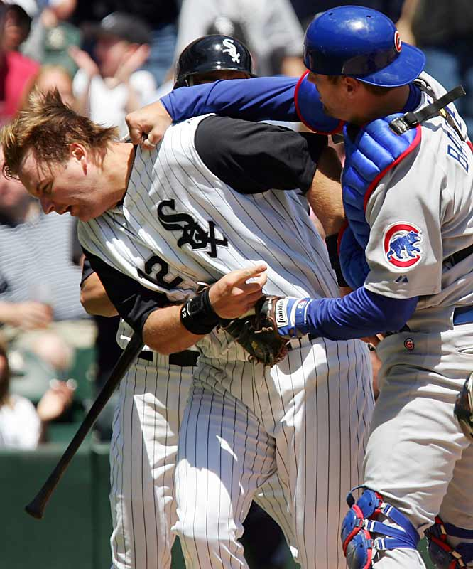 "Cubs catcher Michael Barrett didn't take too kindly to being run over at the plate by his counterpart, White Sox catcher A.J. Pierzynski. After Pierzynski slapped home plate and got up, Barrett grabbed him and punched him in the jaw. ""He grabbed me and said, 'I didn't have the ball' and then he punched me,"" Pierzynski said. ""I was trying to pick up my helmet."""