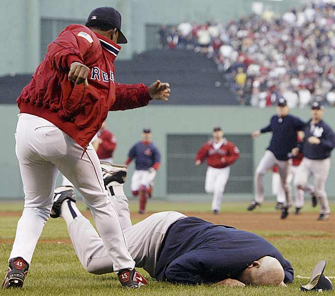 During a Pedro Martinez-Roger Clemens showdown in Game 3 of the ALCS, all heck broke loose. When Yankees bench coach Don Zimmer, 73, lunged toward Martinez, the Red Sox right-hander shoved Zimmer into the Fenway sod. Later in the game New York reliever Jeff Nelson and right fielder Karim Garcia got into a fight with a Fenway Park groundskeeper after he cheered for Boston in the Yankees' bullpen.