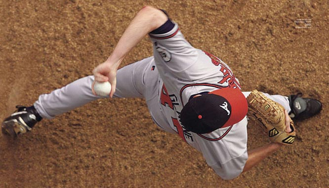 From pages 10-11 of Sports Illustrated: The Baseball Book, Tom Glavine throws a pitch during the 2001 season.