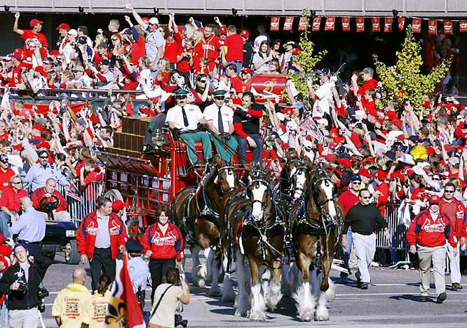 Manager Tony LaRussa rides on the Budweiser cart during the victory parade in downtown St. Louis.