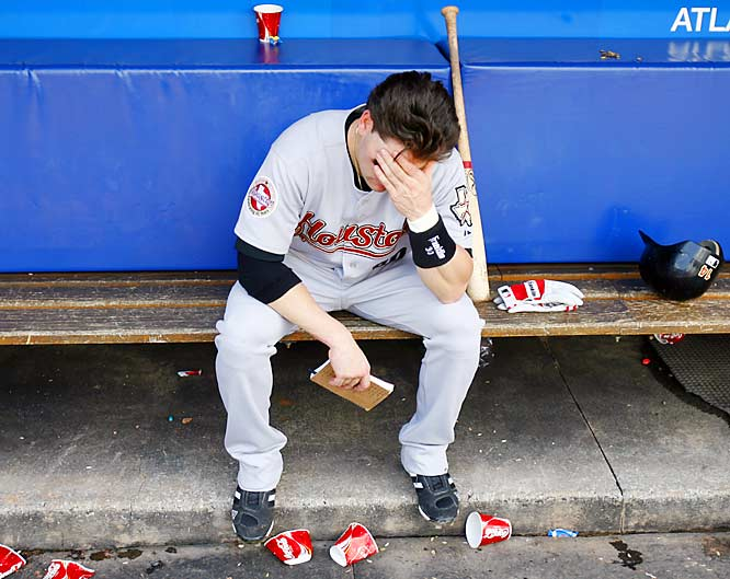 Astros rookie Luke Scott sits dejected, alone in the dugout after a 3-1 loss to the Braves on Sunday, eliminating any chance of a playoff berth for Houston. Scott put up excellent numbers at the plate for the Astros after being called up in mid-July but hit only 4 for 29 last week.