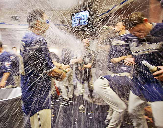 The Padres celebrate clinching a playoff spot after a 3-1 victory over the Diamondbacks on Saturday. After defeating the D-Backs on Sunday as well the Padres captured their second consecutive NL West title, beating the Dodgers in a tiebreaker with the better head-to-head record this season.