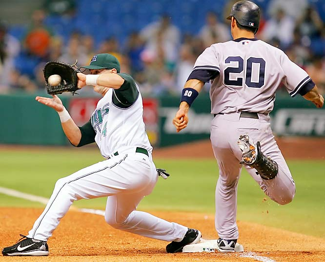 The Yankees' Jorge Posada beats the throw to Devil Rays first baseman Greg Norton for an infield single in the first inning at Tropicana Field on Sept. 25. Posada was the Yankees' seventh batter to reach base in a six-run first, leading to a 16-1 win over the Devil Rays.