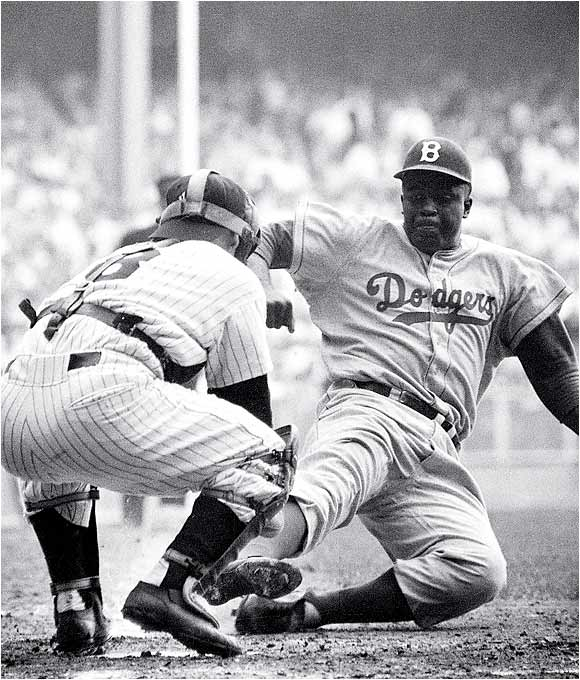 Jackie Robinson stole home in the eighth inning of the 1955 World Series opener ... or did he? Film later showed he should have been called out. The Dodgers got a break, but they ended up losing the game to the Yankees anyway, 6-5.