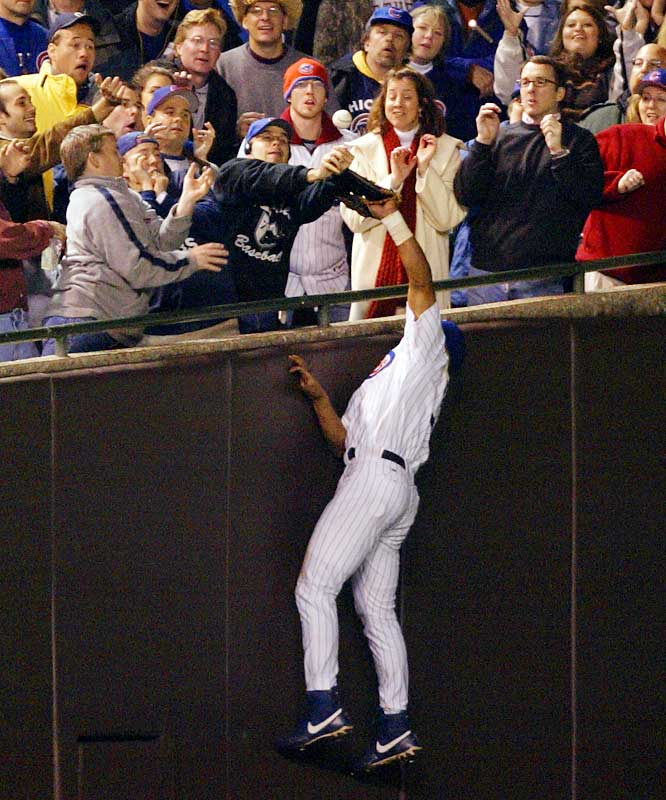 Five outs from Chicago's first trip to the World Series in 58 years, Moises Alou moved toward the left-field stands to catch a foul fly when lifelong Cubs fan Steve Bartman reached up and deflected the ball. Umpire Mike Everitt ruled no interference. The Marlins then scored eight unanswered runs for an 8-3 victory.