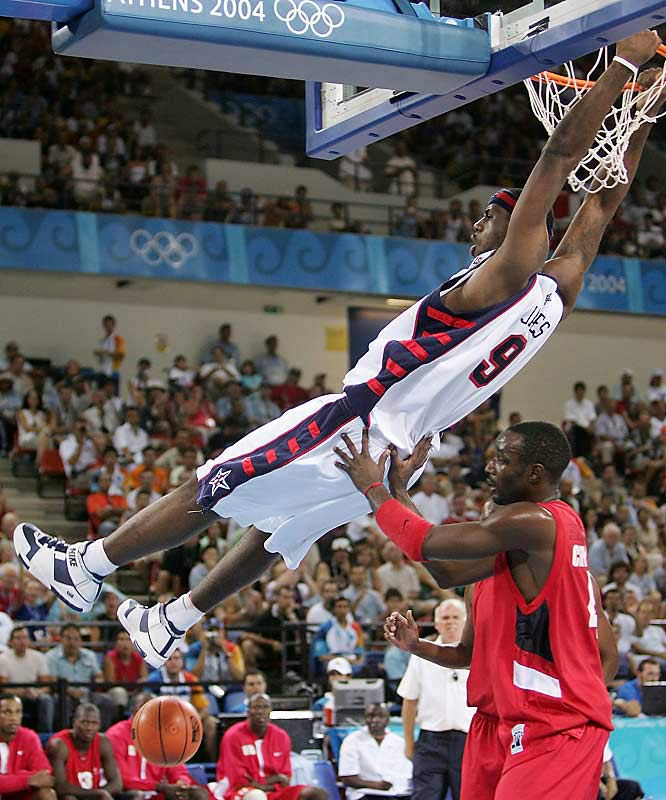 LeBron hangs out after his dunk against Angola in the 2004 Olympics in Athens.