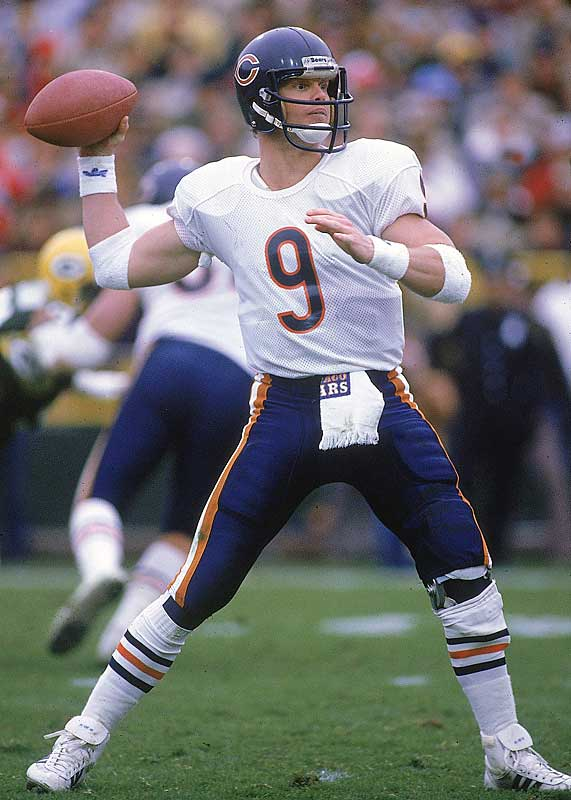 Jim McMahon is remembered more for his part in the Bears Super Bowl Shuffle video, drawing fines from the league office for wearing inappropriate headbands and for mooning photographers. That aside, he had a solid season in 1985, throwing for 2,392 yards and 15 touchdowns. He's the only quarterback to run for more than one touchdown in a Super Bowl.