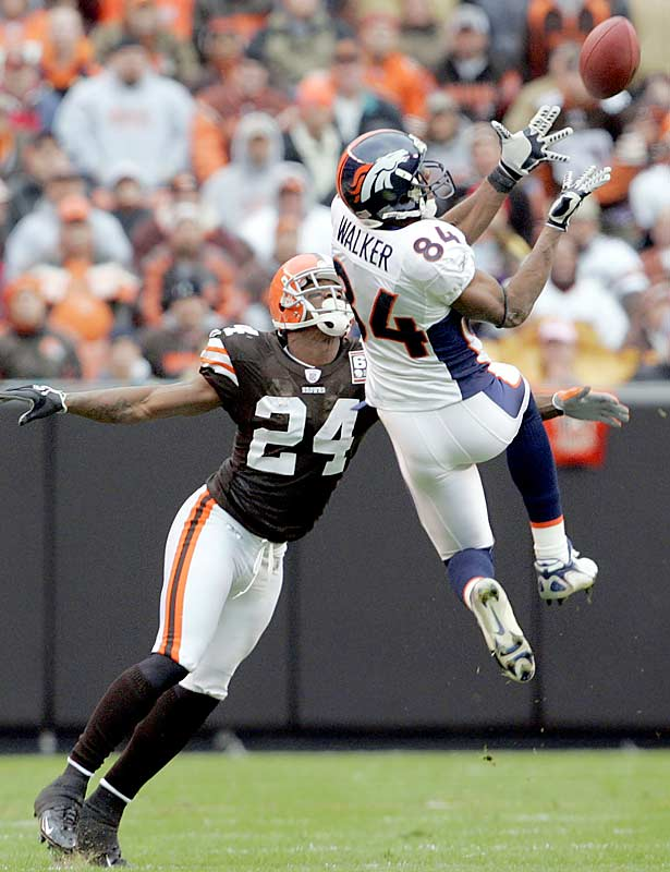 Denver receiver Javon Walker leaps to catch a pass against Cleveland defensive back Gary Baxter at Browns Stadium. Walker had nine receptions for 107 yards to help the Broncos improve to 5-1.