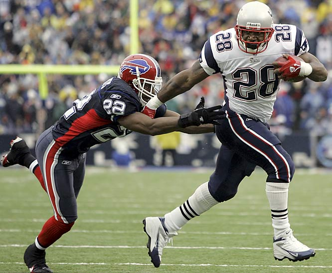 New England running back Corey Dillon breaks a tackle by Buffalo cornerback Nate Clements to score his second touchdown in the first quarter at Buffalo. The Patriots won their seventh straight game against Buffalo, and the 12th of their last 13 meetings.