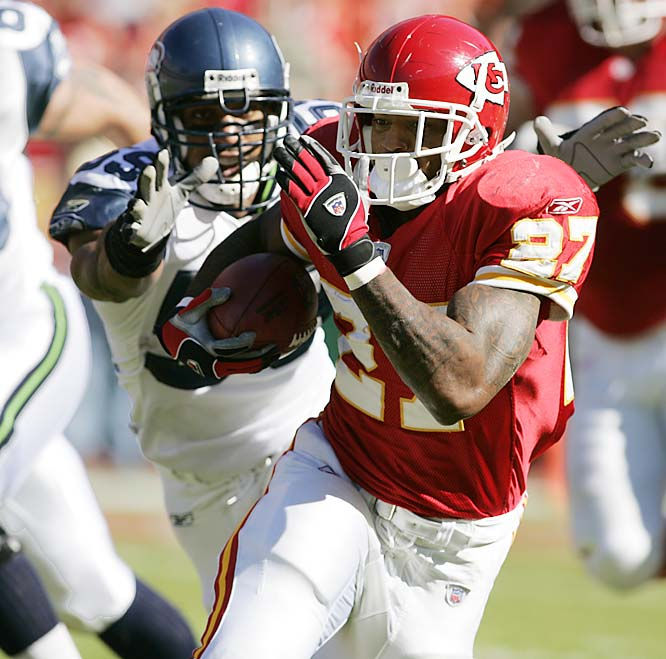 Larry Johnson rushed for 155 yards and scored four touchdowns, three on the ground, against Seattle at Arrowhead Stadium.