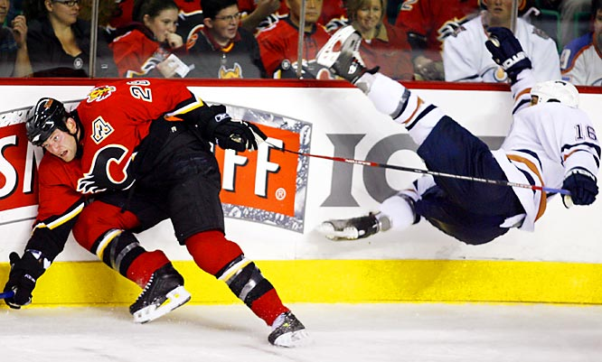 Jarret Stoll of the Oilers was sent flying on Oct. 7, courtesy of Calgary's rockin' Robyn Regehr.
