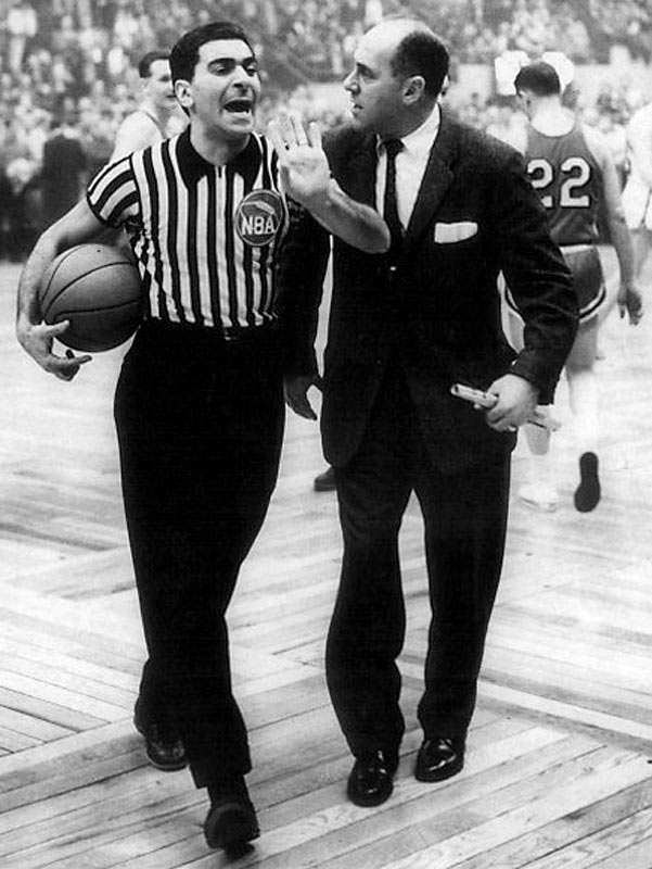 Auerbach argues with referee Mendy Rudolph during a 1958 game.