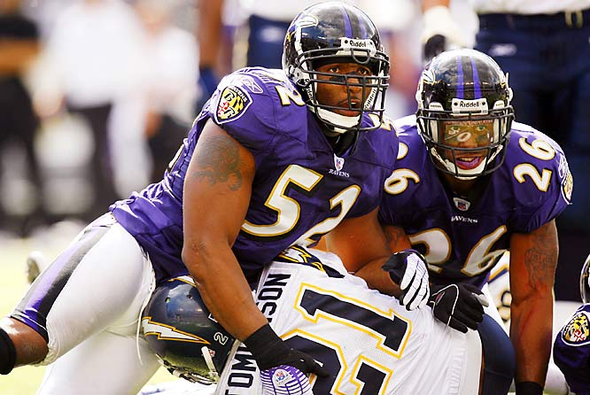 Ravens linebacker Ray Lewis (52) and safety Dawan Landry (26) kneel over Chargers running back LaDainian Tomlinson as the Baltimore defense held strong in the battle of undefeated teams.