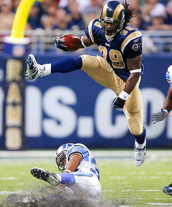 Rams running back Steven Jackson hurdles Lions cornerback Dre Bly as St. Louis improved to 3-1. Jackson had 146 yards and ran for one touchdown.