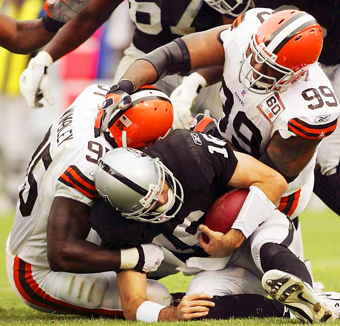 Raiders quarterback Andrew Walter was sacked twice by Browns linebacker Kamerion Wimbley (left) and passed for only 68 yards as the Raiders fell in Oakland.