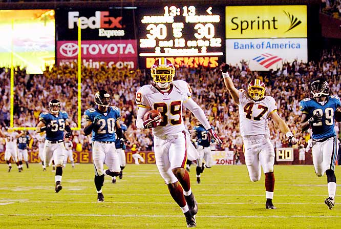 Redskins receiver Santana Moss scored on a 68-yard touchdown reception in overtime, his third TD of the game.
