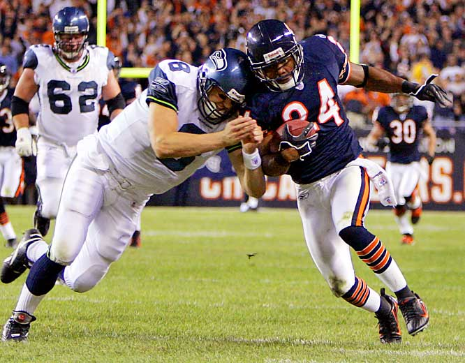 Bears cornerback Ricky Manning Jr. had two interceptions off Seahawks quarterback Matt Hasselbeck, including this one he returned for 39 yards in the second quarter.