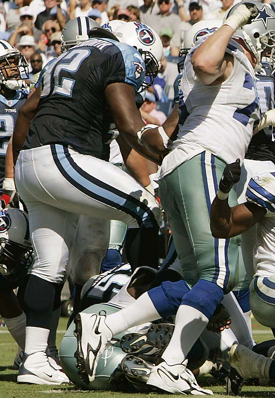 Titans defensive tackle Albert Haynesworth (92) steps on the head of Andre Gurode. Haynesworth was penalized for unsportsmanlike conduct and ejected from the game.