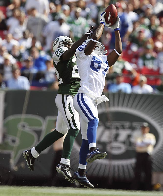 Indianapolis wide receiver Reggie Wayne makes one of his four receptions against the Jets and cornerback Justin Miller.