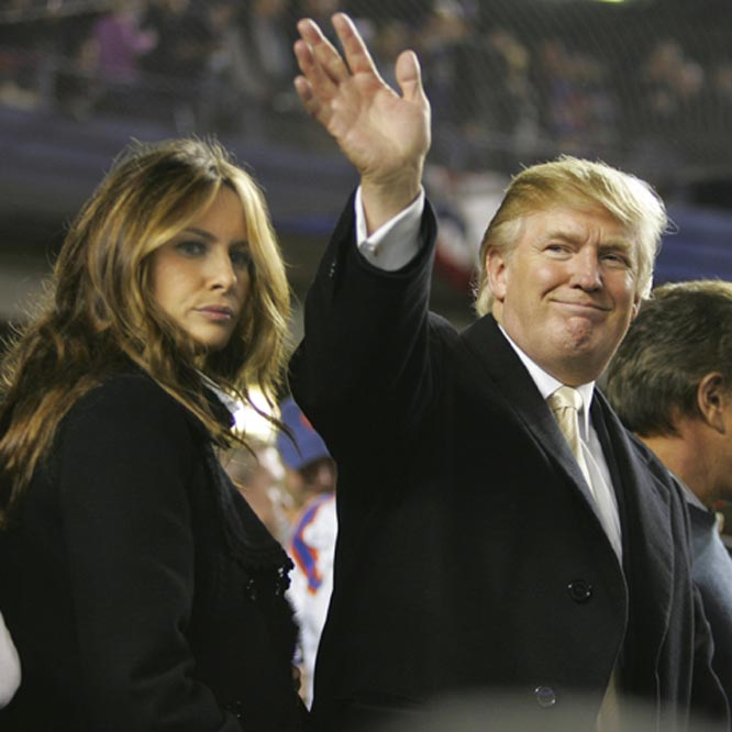 The Donald waves to fans at Game 7 of the Cardinals-Mets NLCS. His wife, Melania, though, is still mad that Trump left the house with his hair looking like that.