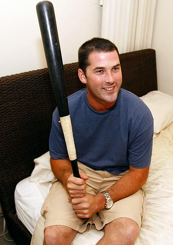 """It's L.A. You never know,"" Booty says of his baseball bat/lethal weapon."