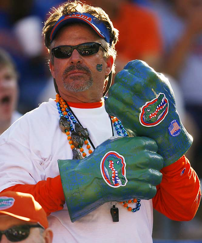 A Florida fan puts on his knockout gloves for the Gators matchup with old friend and South Carolina coach Steve Spurrier.