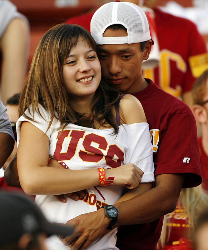 Can we please get these fans a room? A USC-Cal game at the Coliseum isn't the time or place for such canoodling.