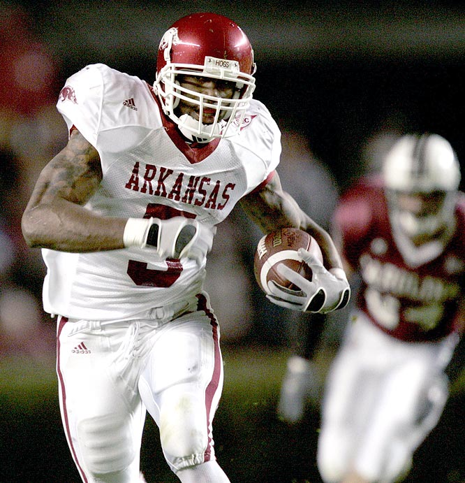 Darren McFadden ran for a career-high 219 yards and two touchdowns on 25 carries as the Razorbacks totaled 267 yards on the ground in holding off the Gamecocks.