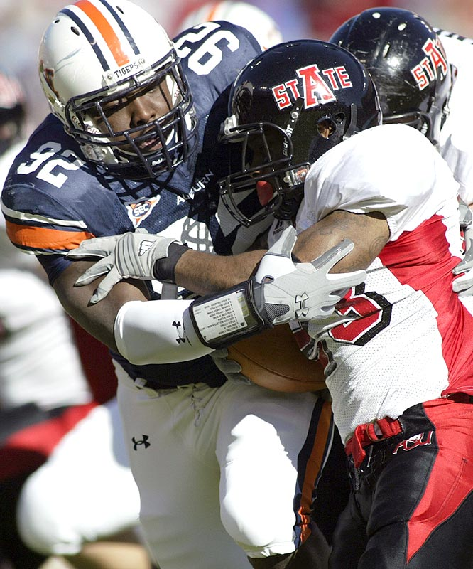 Auburn turned the ball over four times, but Christopher Browder (left) and the Tigers defense held Arkansas State to 177 total yards in notching the win.