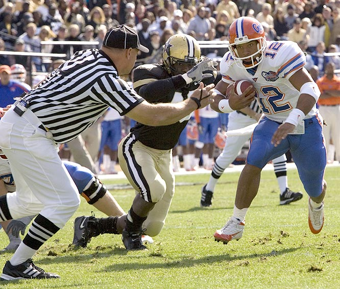 Chris Leak (12) ran for two touchdowns and threw for another as the Gators survived a late rally to win their 16th straight over the Commodores.
