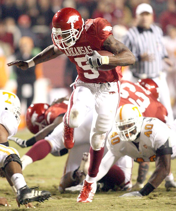 Darren McFadden ran for 181 yards and two touchdowns and threw a touchdown pass as the Razorbacks won their eighth straight, their longest winning streak since 1988.