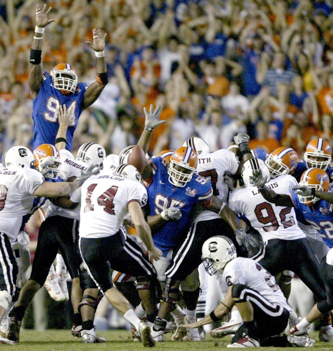 Jarvis Moss (94) blocked Ryan Succop's (14) 48-yard field-goal attempt on the final play as the Gators remain in the national title hunt.
