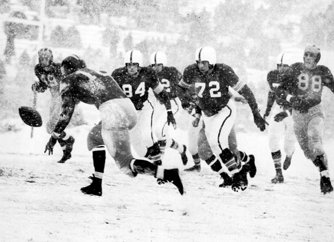 Known as the Snow Bowl, the two teams squared off in a full-scale blizzard -- Columbus' worst in 37 years -- that dropped five inches of snow on the ground. Unranked Michigan earned a safety off a blocked kick and a touchdown off a blocked punt to beat No. 8 Ohio State and earn a trip to the Rose Bowl.