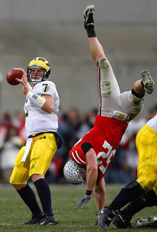 Ohio State linebacker John Kerr got flipped as he attempted to blitz quarterback Chad Henne of Michigan.