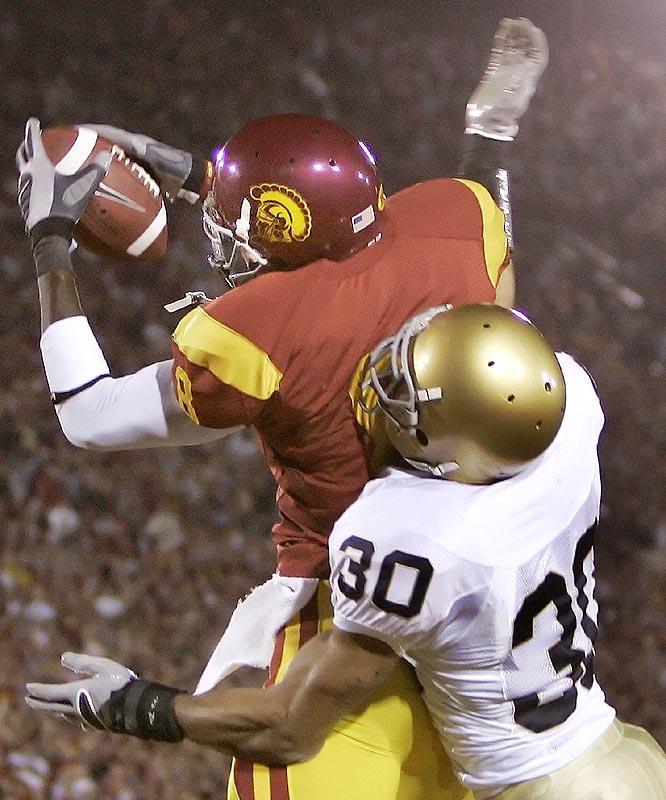Dwayne Jarrett (8) caught three touchdown passes as the Trojans took a step toward their third straight BCS title game.