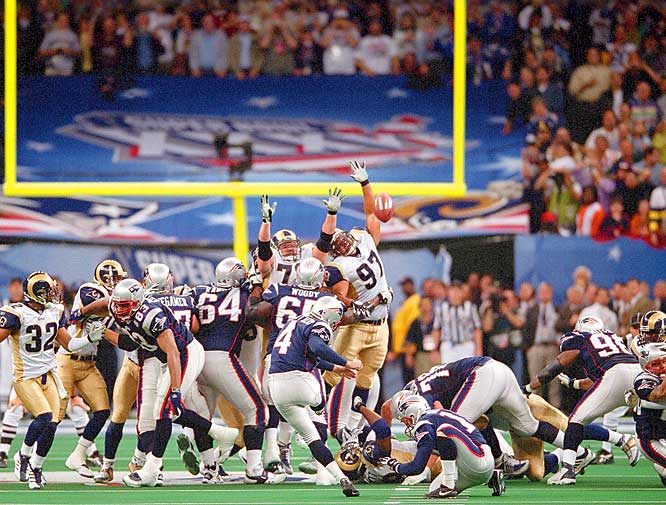 The Patriots were heavy underdogs against the Rams in Super Bowl XXXVI, but they hung tough and were tied when they got the ball with 1:30 remaining. Tom Brady led New England down to St. Louis' 30 to set up a 48-yard field-goal try. Adam Vinatieri nailed it, giving the Patriots their first championship. The kicker with ice water in his veins would also kick the Super Bowl winner two years later against the Panthers.