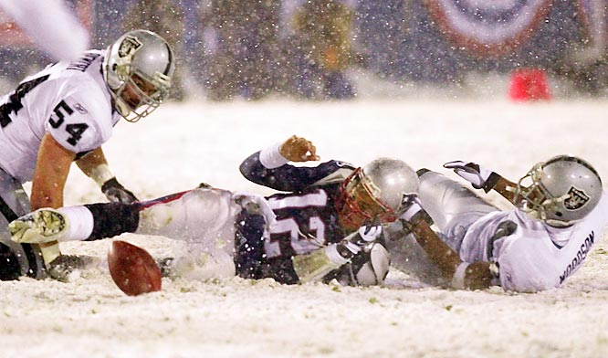 With time running out in the AFC divisional playoffs, the Patriots were driving on the Raiders in a driving snowstorm. New England quarterback Tom Brady was apparently sacked by blitzing Oakland cornerback Charles Woodson and fumbled the ball. The Raiders recovered it, but the officials ruled that Brady was attempting a pass, thus no turnover. The decision was based on what is known as the tuck rule, which states that a QB needs to tuck the ball back into his body before a fumble can occur. New England kept the ball and tied the game near the end of regulation on an Adam Vinatieri field goal in the snow. The Patriots eventually won on a Vinatieri field goal in overtime.
