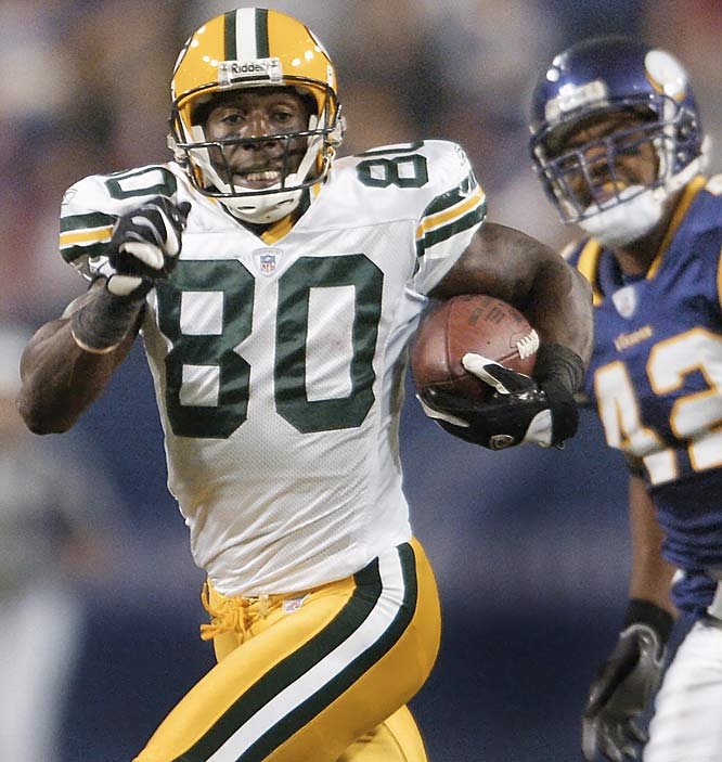 Green Bay wideout Donald Driver races past Minnesota safety Darren Sharper for an 82-yard touchdown reception late in the first half.  Driver caught six passes for 191 yards and is now fifth in the NFL with 771 receiving yards on the season.