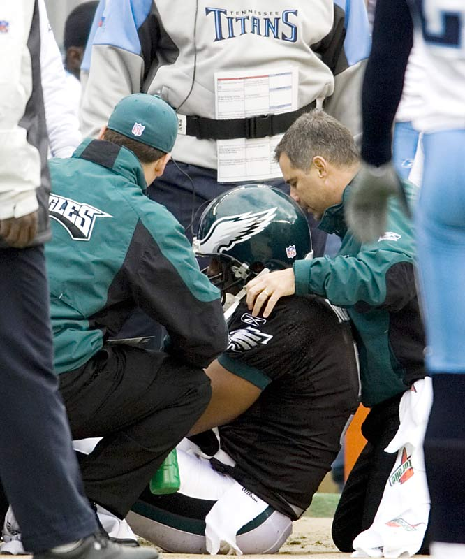 Donovan McNabb grabbed his right knee and fell to the ground after a seemingly harmless bump out of bounds by Tennessee's Kyle Vanden Bosch.  McNabb will miss the rest of the year with a torn knee ligament as the Eagles will finish out a season for the third time in five years without their star quarterback.