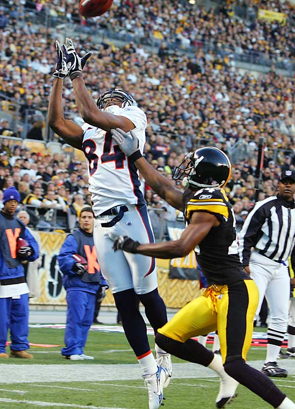 Denver receiver Javon Walker catches a 10-yard touchdown pass in the first quarter against Pittsburgh cornerback Ike Taylor. Walker scored three touchdowns, including one off a 72-yard run in the third quarter.