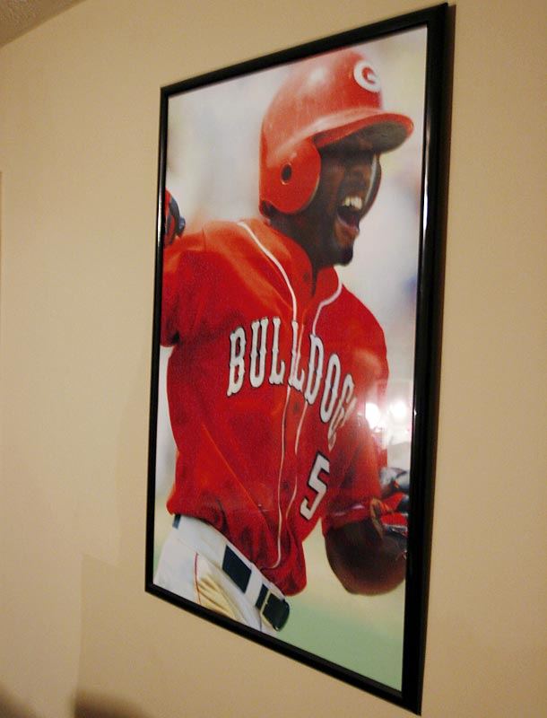 Centerfielder Jonathan Wyatt lives across the hall from Jake's room.This picture, Wyatt said, is one of the two posters of himself hanging on the wall.