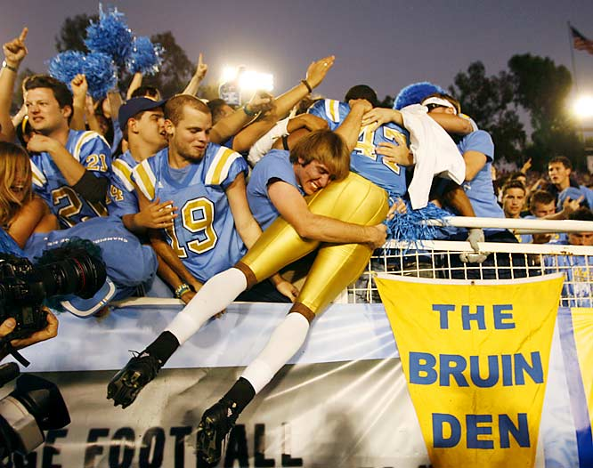UCLA freshman RB Chane Moline was swamped by fans after the Bruins' 13-9 upset of USC on Saturday.