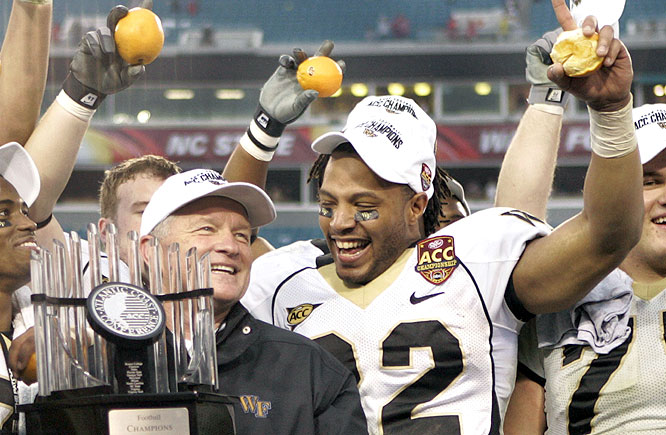 Jim Grobe (left) and the Demon Deacons won their first ACC title since 1970, while also earning a trip to the Orange Bowl.