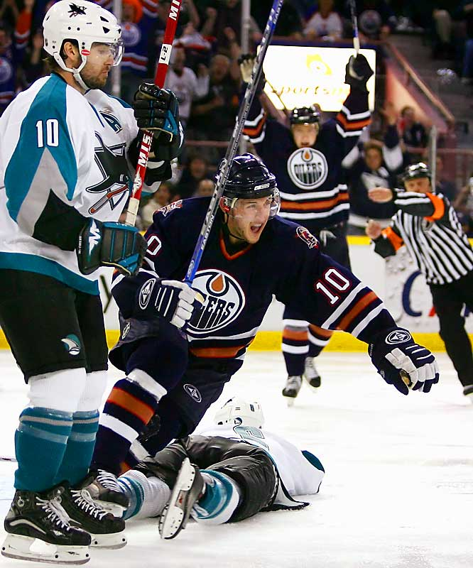 On the brink of falling into an 0-3 hole in the series, the gritty Oilers returned home and bombarded Sharks' netminder Vesa Toskala with 58 shots. Edmonton needed every one of them. Raffi Torres of the Oilers tied the game 2-2 with a wrister at 13:13 of the third period. Joe Thornton nearly won it for the Sharks, but his shot hit the post and the teams had to battle into a third OT period before Edmonton's Ryan Smyth backhanded a pass from behind the net to Shawn Horcoff (left), who poked the puck past the fallen Toskala at the 2:24 mark.